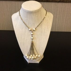 Long gold and pearl tassel necklace